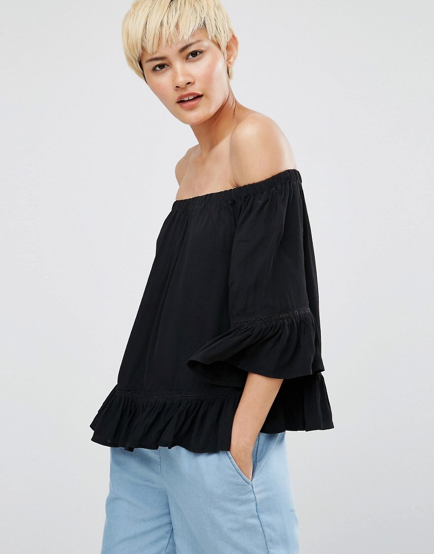 Gunta Cold Shoulder Blouse Black - neckline: off the shoulder; pattern: plain; predominant colour: black; occasions: casual; length: standard; style: top; fibres: viscose/rayon - 100%; fit: loose; sleeve length: 3/4 length; sleeve style: standard; pattern type: fabric; texture group: jersey - stretchy/drapey; season: a/w 2016; wardrobe: highlight