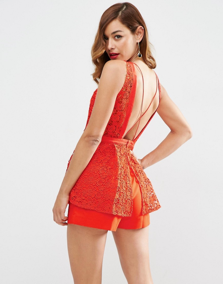 Red Carpet Premium Lace Playsuit With Peplum Detail Red - neckline: round neck; fit: tailored/fitted; sleeve style: sleeveless; length: short shorts; predominant colour: true red; occasions: evening, occasion; fibres: polyester/polyamide - 100%; back detail: crossover; sleeve length: sleeveless; texture group: lace; style: playsuit; pattern type: fabric; pattern size: standard; pattern: patterned/print; season: a/w 2016; wardrobe: event