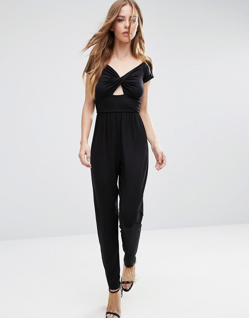 Halloween Bardot Twist Jersey Jumpsuit With Peg Leg Black - length: standard; neckline: low v-neck; sleeve style: capped; pattern: plain; predominant colour: black; occasions: evening; fit: body skimming; fibres: polyester/polyamide - stretch; waist detail: cut out detail; sleeve length: short sleeve; style: jumpsuit; pattern type: fabric; texture group: jersey - stretchy/drapey; season: a/w 2016