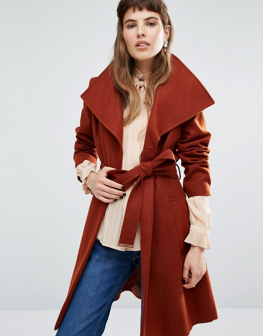 Wrap Belted Coat Rust - pattern: plain; collar: wide lapels; length: on the knee; style: wrap around; fit: slim fit; predominant colour: terracotta; occasions: casual; fibres: polyester/polyamide - stretch; waist detail: belted waist/tie at waist/drawstring; sleeve length: long sleeve; sleeve style: standard; collar break: medium; pattern type: fabric; texture group: woven bulky/heavy; season: a/w 2016; wardrobe: highlight