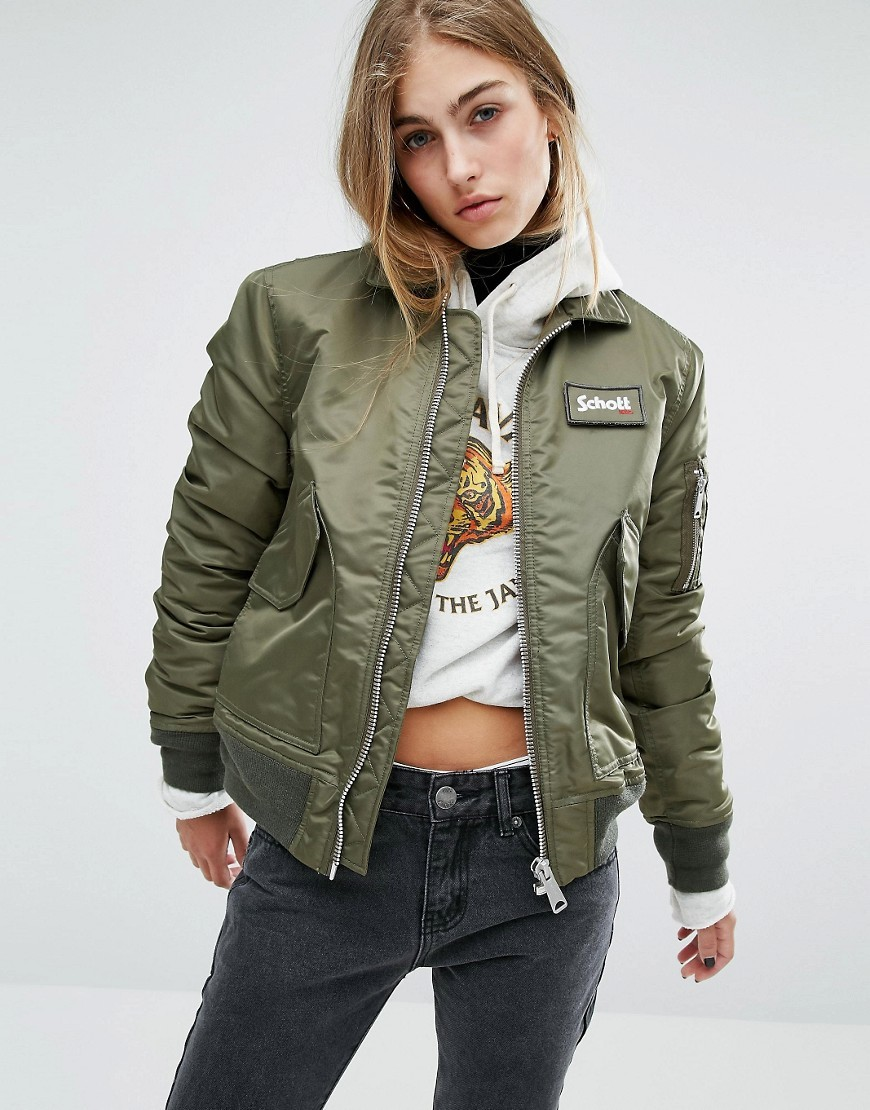 Coach Bomber Jacket With Woven Badge On Front Army Khaki - sleeve style: puffed; pattern: plain; style: bomber; predominant colour: khaki; occasions: casual; length: standard; fit: straight cut (boxy); fibres: polyester/polyamide - 100%; collar: shirt collar/peter pan/zip with opening; sleeve length: long sleeve; collar break: high; pattern type: fabric; texture group: other - bulky/heavy; wardrobe: basic; season: a/w 2016