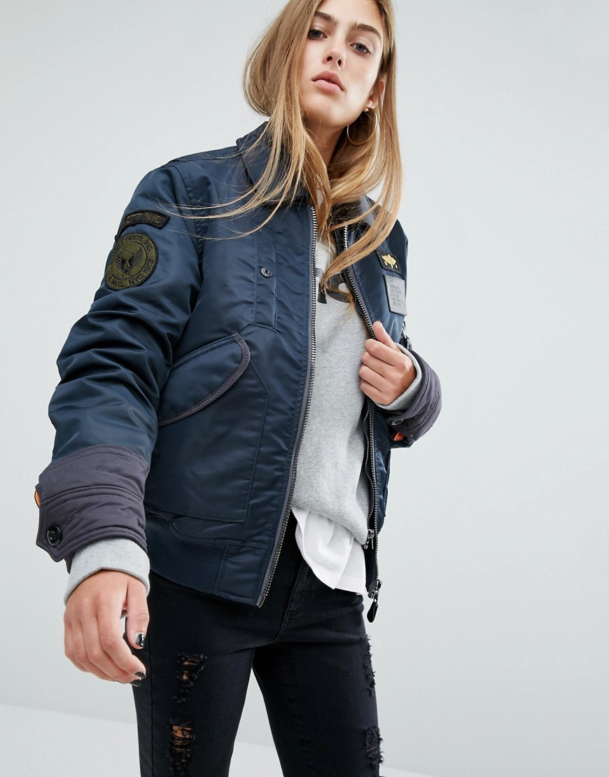 Coach Oversized Flight Jacket With Double Layer Collar And Woven Badges Navy - sleeve style: puffed; style: bomber; predominant colour: navy; occasions: casual; length: standard; fit: straight cut (boxy); fibres: polyester/polyamide - 100%; collar: shirt collar/peter pan/zip with opening; sleeve length: long sleeve; collar break: high; pattern type: fabric; pattern size: standard; pattern: patterned/print; texture group: other - bulky/heavy; embellishment: embroidered; season: a/w 2016