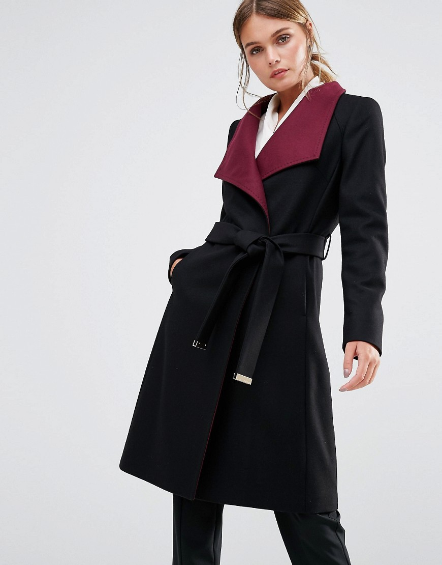 Afina Wrap Coat With Contrast Lapel Black - pattern: plain; collar: wide lapels; length: on the knee; style: wrap around; fit: slim fit; hip detail: draws attention to hips; secondary colour: hot pink; predominant colour: black; occasions: casual; fibres: wool - mix; waist detail: belted waist/tie at waist/drawstring; sleeve length: long sleeve; sleeve style: standard; collar break: medium; pattern type: fabric; texture group: woven light midweight; multicoloured: multicoloured; season: a/w 2016; wardrobe: highlight