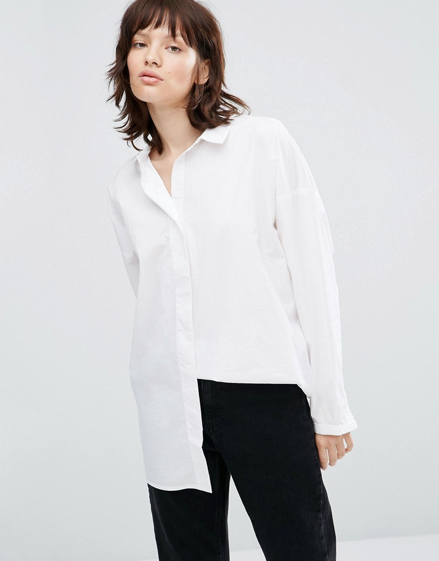 Tulum Shirt White - neckline: shirt collar/peter pan/zip with opening; pattern: plain; length: below the bottom; style: shirt; predominant colour: white; occasions: work; fibres: cotton - 100%; fit: body skimming; sleeve length: long sleeve; sleeve style: standard; texture group: cotton feel fabrics; pattern type: fabric; season: a/w 2016