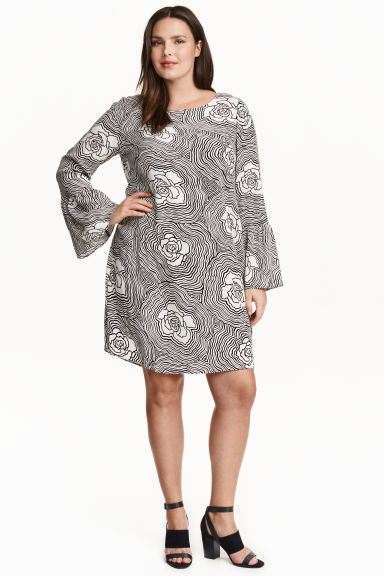 + Trumpet Sleeved Dress - style: tunic; length: mid thigh; neckline: round neck; sleeve style: volant; secondary colour: white; predominant colour: black; occasions: casual, creative work; fit: straight cut; fibres: polyester/polyamide - 100%; sleeve length: long sleeve; pattern type: fabric; pattern size: standard; pattern: florals; texture group: woven light midweight; season: a/w 2016