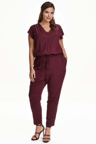 + V Neck Jumpsuit - length: standard; neckline: v-neck; pattern: plain; predominant colour: burgundy; occasions: evening; fit: body skimming; fibres: viscose/rayon - 100%; sleeve length: short sleeve; sleeve style: standard; style: jumpsuit; pattern type: fabric; texture group: jersey - stretchy/drapey; season: a/w 2016; wardrobe: event