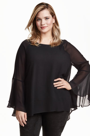 + Trumpet Sleeved Tunic - neckline: round neck; sleeve style: angel/waterfall; pattern: plain; style: blouse; predominant colour: black; occasions: evening, creative work; length: standard; fibres: polyester/polyamide - 100%; fit: loose; sleeve length: long sleeve; texture group: sheer fabrics/chiffon/organza etc.; pattern type: fabric; season: a/w 2016
