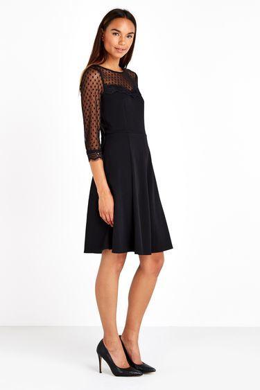 Black Polka Dot Mesh Fit And Flare Dress - style: smock; neckline: round neck; fit: loose; pattern: plain; predominant colour: black; occasions: evening; length: on the knee; fibres: polyester/polyamide - stretch; hip detail: soft pleats at hip/draping at hip/flared at hip; sleeve length: 3/4 length; sleeve style: standard; pattern type: fabric; texture group: jersey - stretchy/drapey; embellishment: lace; shoulder detail: sheer at shoulder; season: a/w 2016; wardrobe: event; trends: sparkle