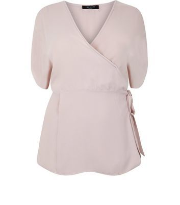 Curve Pink Tie Side Wrap Top - neckline: v-neck; pattern: plain; style: wrap/faux wrap; waist detail: belted waist/tie at waist/drawstring; predominant colour: blush; occasions: casual; length: standard; fibres: polyester/polyamide - 100%; fit: body skimming; sleeve length: short sleeve; sleeve style: standard; texture group: sheer fabrics/chiffon/organza etc.; pattern type: fabric; season: a/w 2016
