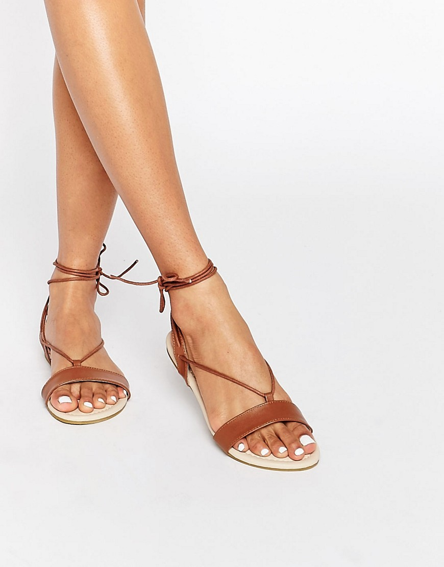 Flawless Tie Leg Sandals Choc - predominant colour: tan; occasions: casual, holiday; material: faux leather; heel height: flat; ankle detail: ankle tie; heel: block; toe: open toe/peeptoe; style: strappy; finish: plain; pattern: plain; season: a/w 2016; wardrobe: highlight