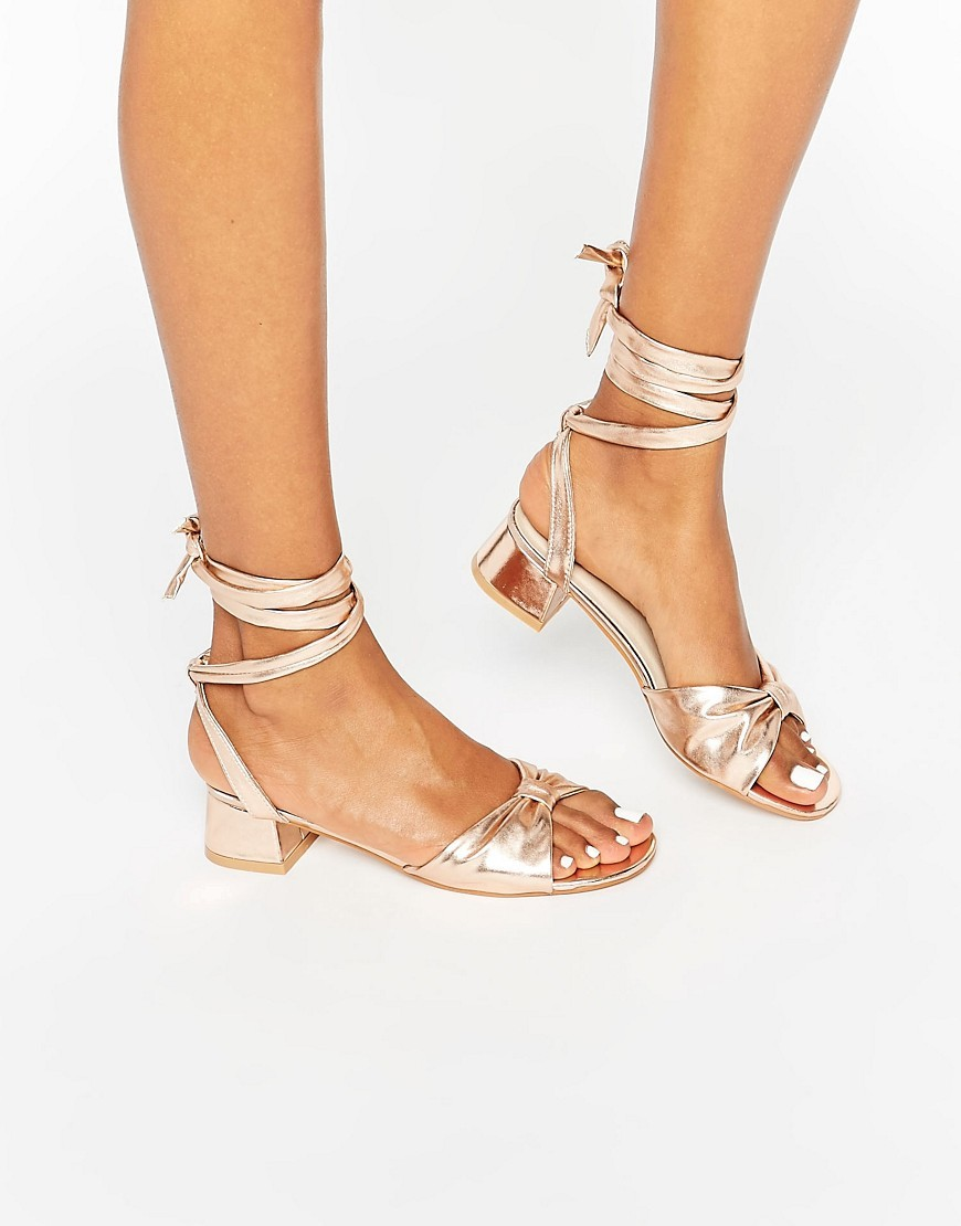 Favon Knot Tie Leg Sandals Rose Gold - predominant colour: gold; occasions: casual, evening, holiday; material: faux leather; heel height: mid; ankle detail: ankle tie; heel: block; toe: open toe/peeptoe; style: strappy; finish: metallic; pattern: plain; season: a/w 2016; wardrobe: highlight