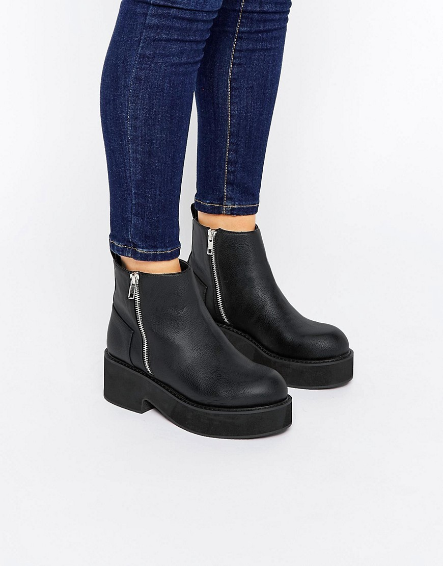 Achem Chunky Zip Boots Black - predominant colour: black; occasions: casual, creative work; material: faux leather; heel height: mid; heel: wedge; toe: round toe; boot length: ankle boot; style: standard; finish: plain; pattern: plain; shoe detail: platform; wardrobe: basic; season: a/w 2016