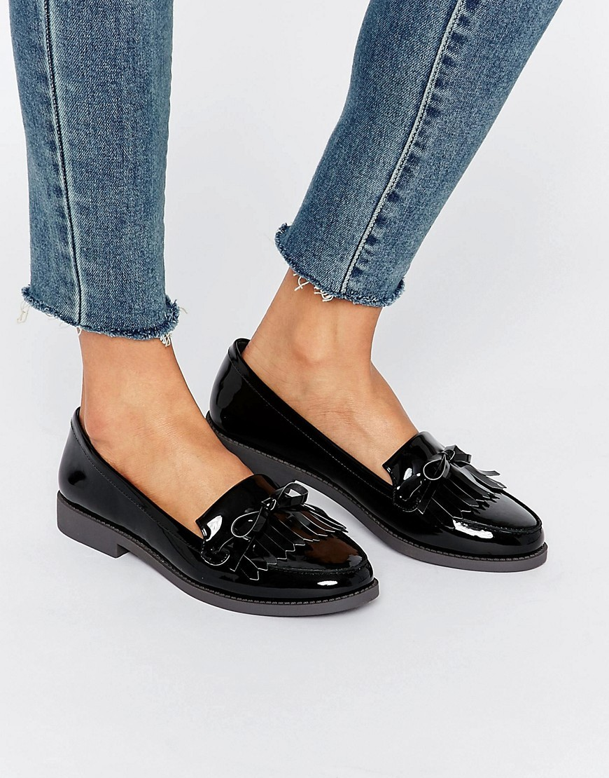 Metallic Fringe Loafer Black - predominant colour: black; occasions: casual, work, creative work; material: leather; heel height: flat; toe: round toe; style: loafers; finish: patent; pattern: plain; season: a/w 2016