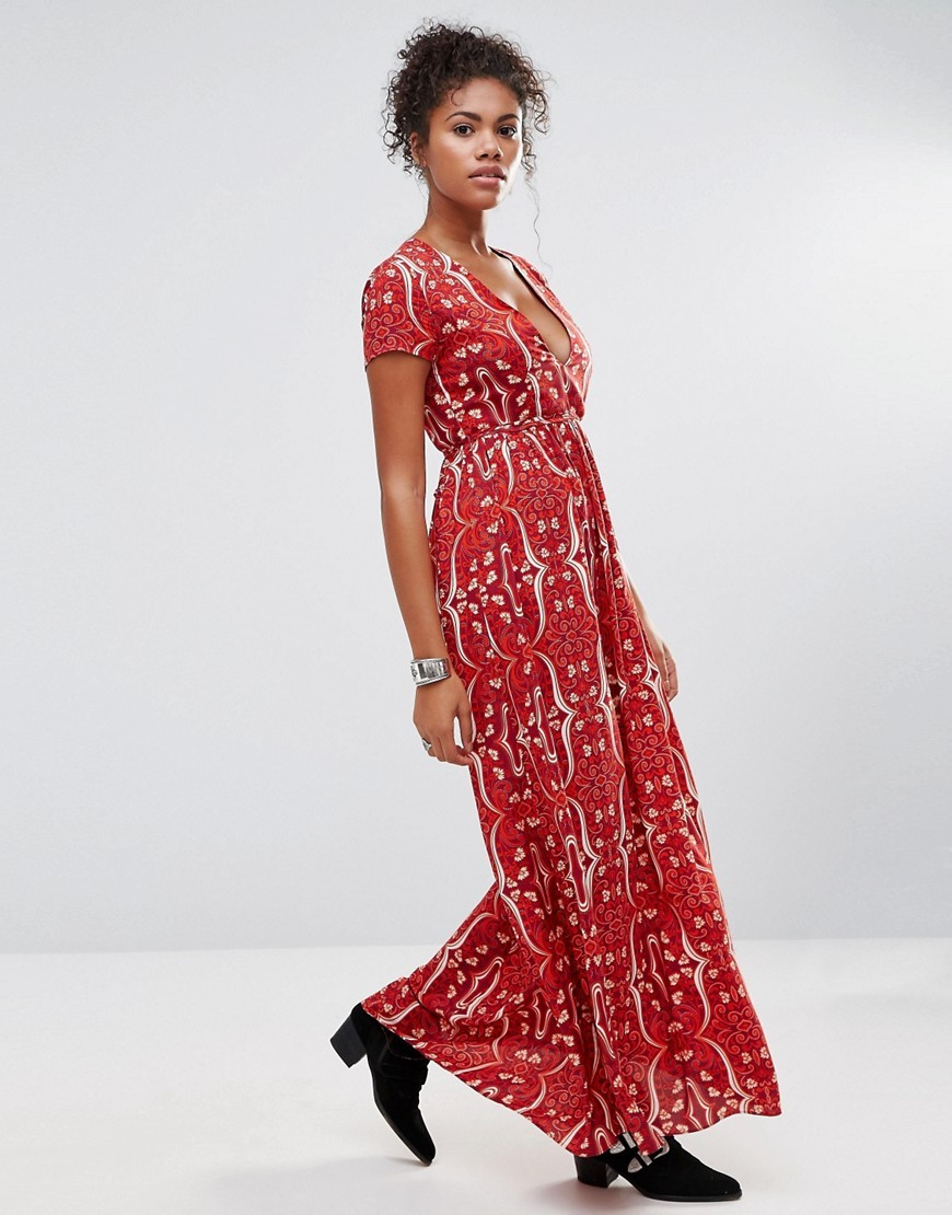 Floral Maxi Dress With V Neck Magneta Orange - neckline: low v-neck; style: maxi dress; secondary colour: white; predominant colour: true red; occasions: casual; length: floor length; fit: body skimming; fibres: viscose/rayon - 100%; sleeve length: short sleeve; sleeve style: standard; pattern type: fabric; pattern: patterned/print; texture group: jersey - stretchy/drapey; multicoloured: multicoloured; season: a/w 2016; wardrobe: highlight