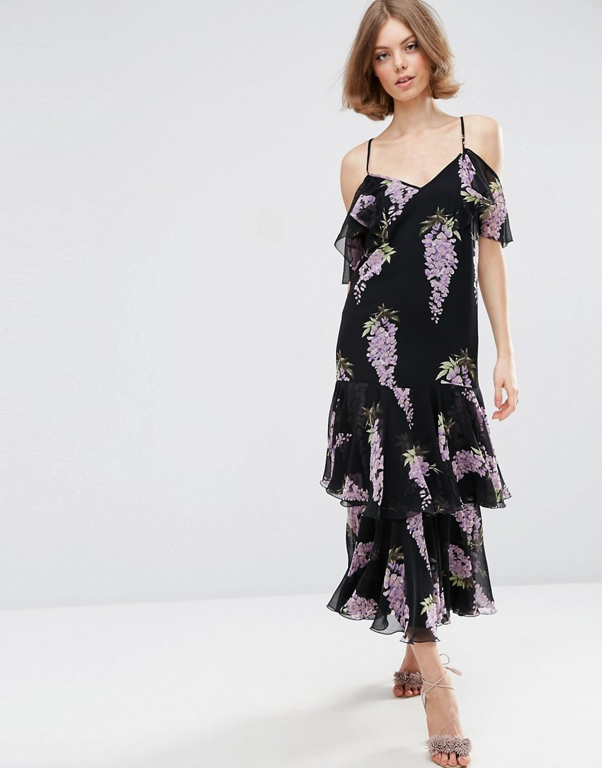 Premium Frill Maxi Dress In Wisteria Floral Multi - neckline: low v-neck; style: maxi dress; length: ankle length; secondary colour: mid grey; predominant colour: black; occasions: evening; fit: body skimming; fibres: polyester/polyamide - 100%; hip detail: adds bulk at the hips; shoulder detail: cut out shoulder; sleeve length: short sleeve; sleeve style: standard; texture group: sheer fabrics/chiffon/organza etc.; pattern type: fabric; pattern: patterned/print; multicoloured: multicoloured; season: a/w 2016; wardrobe: event
