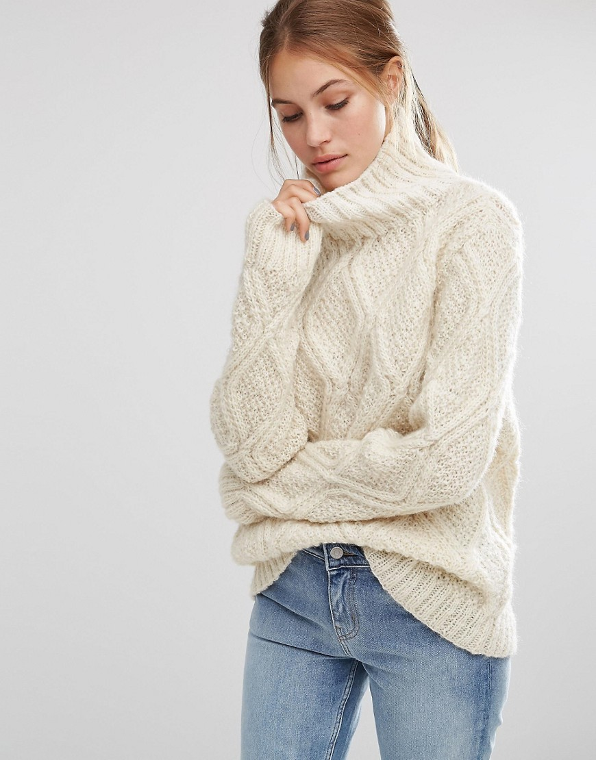 Cable Hand Knit Unbleached Wool High Neck Oversized Jumper Cream - neckline: roll neck; style: standard; pattern: cable knit; predominant colour: ivory/cream; occasions: casual; length: standard; fibres: wool - 100%; fit: loose; sleeve length: long sleeve; sleeve style: standard; texture group: knits/crochet; pattern type: knitted - other; season: a/w 2016; wardrobe: highlight