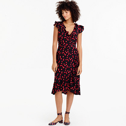 Silk Wrap Dress In Cherry Print - style: faux wrap/wrap; length: below the knee; neckline: v-neck; sleeve style: sleeveless; secondary colour: true red; predominant colour: black; occasions: evening; fit: body skimming; fibres: silk - 100%; sleeve length: sleeveless; texture group: silky - light; bust detail: tiers/frills/bulky drapes/pleats; pattern type: fabric; pattern size: standard; pattern: patterned/print; season: a/w 2016