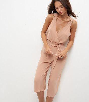 Shell Pink Buckle Wrap Front Jumpsuit - neckline: low v-neck; pattern: plain; sleeve style: sleeveless; waist detail: belted waist/tie at waist/drawstring; predominant colour: blush; occasions: evening; length: calf length; fit: body skimming; fibres: polyester/polyamide - 100%; sleeve length: sleeveless; style: jumpsuit; pattern type: fabric; texture group: jersey - stretchy/drapey; season: a/w 2016; wardrobe: event