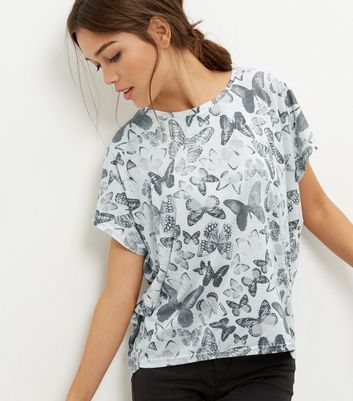 White Butterfly Print Cocoon T Shirt - style: t-shirt; predominant colour: white; secondary colour: mid grey; occasions: casual; length: standard; fibres: polyester/polyamide - mix; fit: body skimming; neckline: crew; sleeve length: short sleeve; sleeve style: standard; pattern type: fabric; pattern size: standard; pattern: patterned/print; texture group: jersey - stretchy/drapey; multicoloured: multicoloured; season: a/w 2016