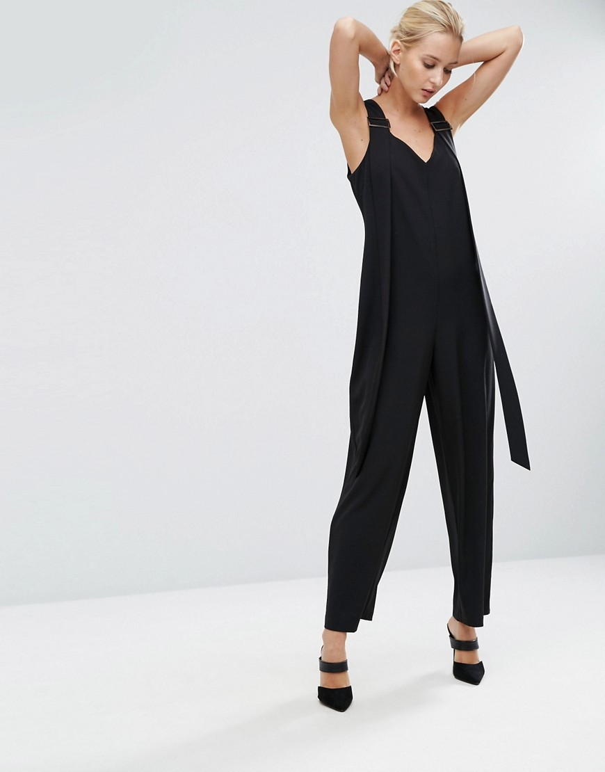 Jumpsuit With Wide Leg And Tab Detail Black - length: standard; neckline: v-neck; fit: loose; pattern: plain; sleeve style: sleeveless; predominant colour: black; occasions: evening; fibres: polyester/polyamide - stretch; sleeve length: sleeveless; style: jumpsuit; pattern type: fabric; texture group: jersey - stretchy/drapey; season: a/w 2016; wardrobe: event