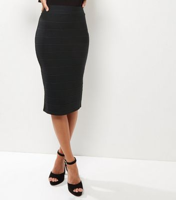 Black Bandage Pencil Skirt - length: below the knee; pattern: plain; style: pencil; fit: tailored/fitted; waist: mid/regular rise; predominant colour: black; occasions: evening, work; fibres: polyester/polyamide - stretch; texture group: jersey - clingy; pattern type: fabric; wardrobe: basic; season: a/w 2016