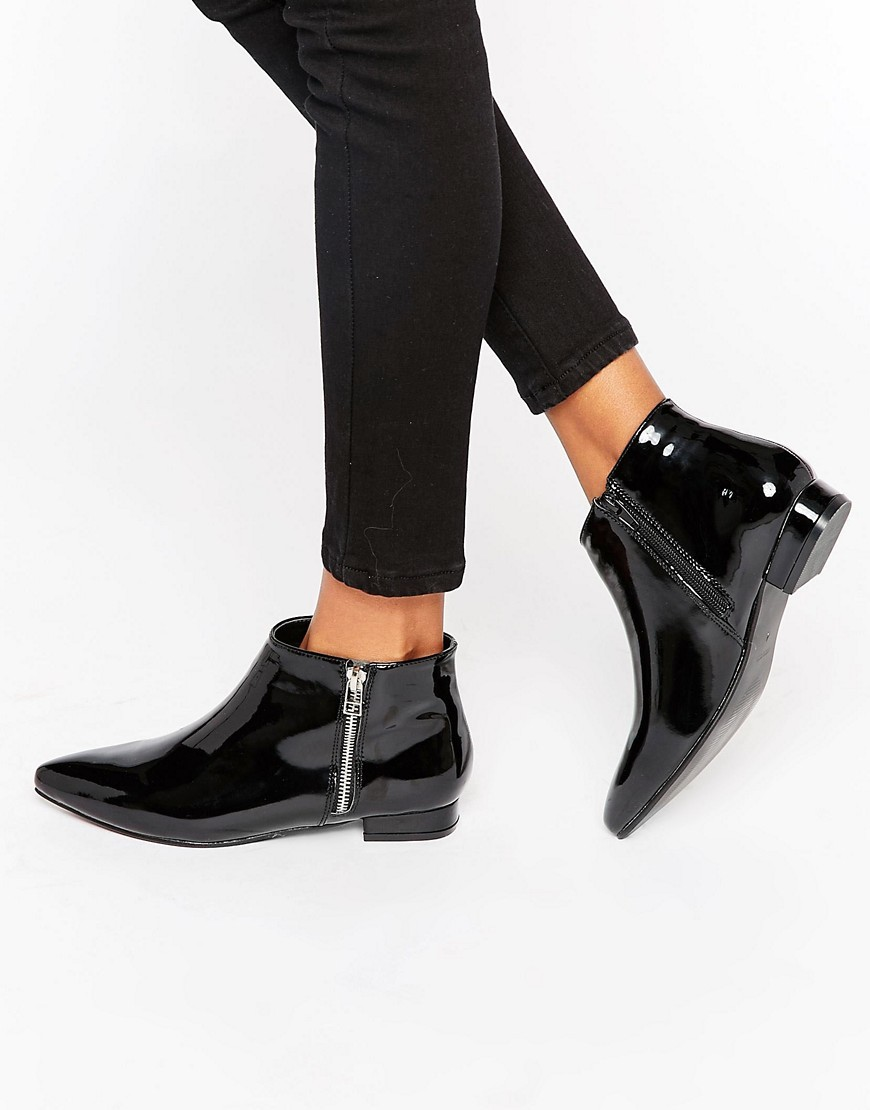 Patent Point Flat Side Zip Boots Black Patent - predominant colour: black; occasions: casual, creative work; material: faux leather; heel height: flat; heel: block; toe: pointed toe; boot length: ankle boot; style: standard; finish: patent; pattern: plain; season: a/w 2016