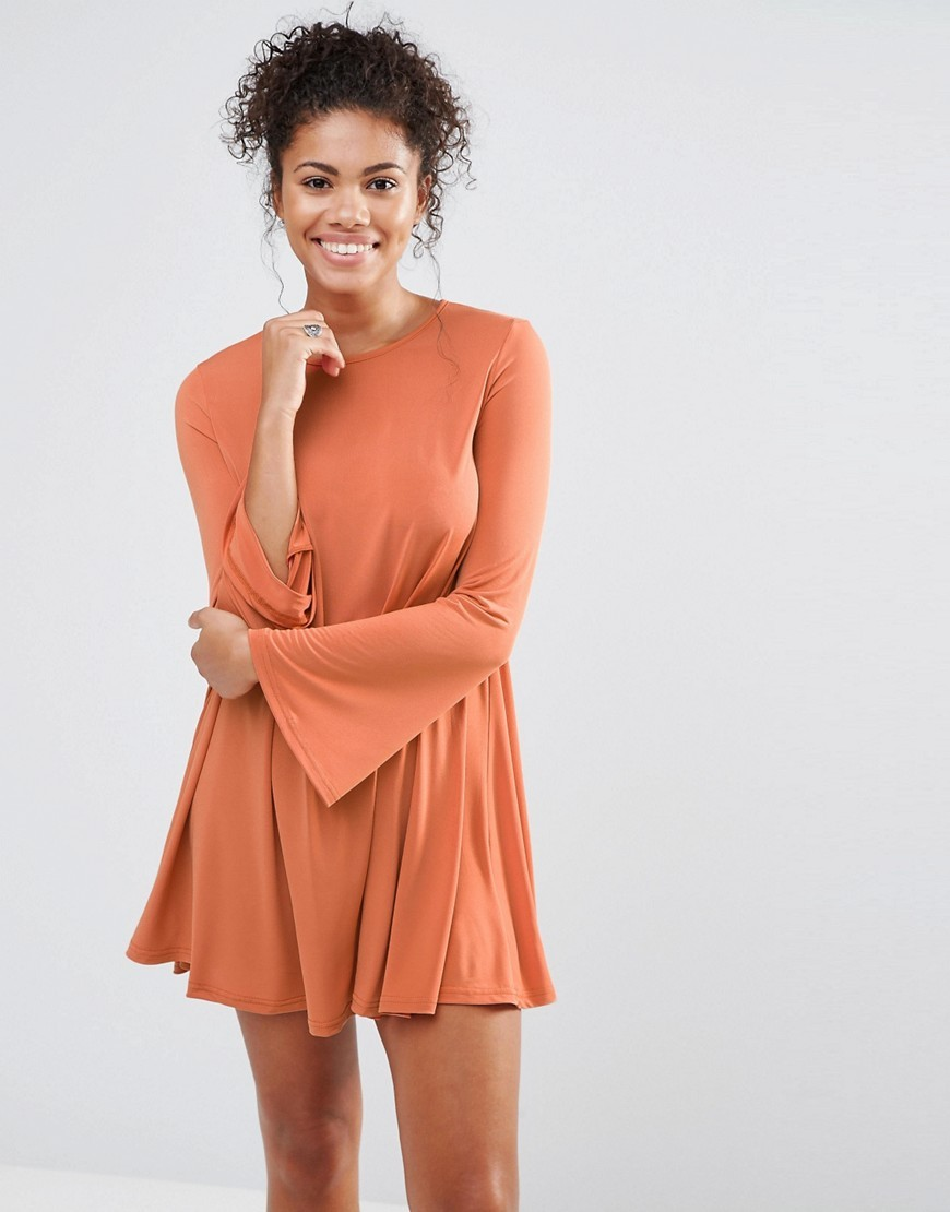 Swing Dress Tan - style: trapeze; length: mini; sleeve style: bell sleeve; fit: loose; pattern: plain; predominant colour: coral; occasions: casual; fibres: polyester/polyamide - stretch; neckline: crew; sleeve length: long sleeve; pattern type: fabric; texture group: jersey - stretchy/drapey; season: a/w 2016