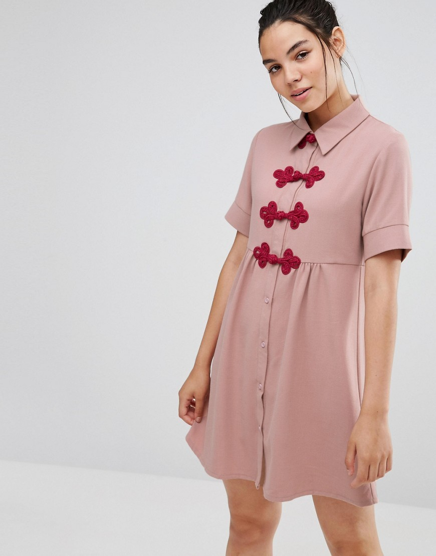 Short Sleeve Shirt Dress With Crochet Fastenings Pink - style: shirt; neckline: shirt collar/peter pan/zip with opening; pattern: plain; predominant colour: pink; occasions: casual; length: just above the knee; fit: body skimming; fibres: polyester/polyamide - stretch; sleeve length: short sleeve; sleeve style: standard; pattern type: fabric; texture group: jersey - stretchy/drapey; season: a/w 2016; wardrobe: highlight