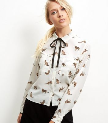 White Cat Print Tie Neck Cropped Shirt - neckline: pussy bow; style: blouse; predominant colour: white; secondary colour: camel; occasions: casual; length: standard; fibres: polyester/polyamide - 100%; fit: body skimming; sleeve length: long sleeve; sleeve style: standard; texture group: sheer fabrics/chiffon/organza etc.; pattern type: fabric; pattern size: standard; pattern: patterned/print; multicoloured: multicoloured; season: a/w 2016