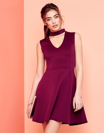 Choker Neck Skater Dress - length: mid thigh; pattern: plain; sleeve style: sleeveless; waist detail: fitted waist; predominant colour: magenta; occasions: evening, occasion; fit: fitted at waist & bust; style: fit & flare; neckline: peep hole neckline; fibres: polyester/polyamide - 100%; hip detail: subtle/flattering hip detail; sleeve length: sleeveless; texture group: structured shiny - satin/tafetta/silk etc.; pattern type: fabric; season: a/w 2016; wardrobe: event