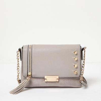 Womens Grey Studded Cross Body Bag - secondary colour: gold; predominant colour: light grey; occasions: casual, creative work; type of pattern: standard; style: messenger; length: across body/long; size: small; material: faux leather; embellishment: studs; pattern: plain; finish: plain; season: a/w 2016; wardrobe: highlight