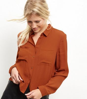 Brown Crop Shirt - neckline: shirt collar/peter pan/zip with opening; pattern: plain; style: shirt; predominant colour: terracotta; occasions: casual, creative work; length: standard; fibres: viscose/rayon - 100%; fit: body skimming; sleeve length: long sleeve; sleeve style: standard; texture group: sheer fabrics/chiffon/organza etc.; pattern type: fabric; season: a/w 2016; wardrobe: highlight