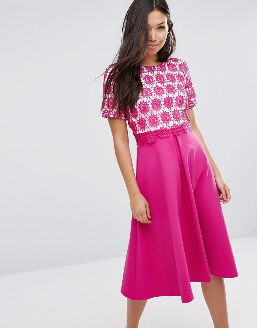 Overlay Lace Midi Dress With Scuba Skirt Fuschia - length: below the knee; style: full skirt; secondary colour: white; predominant colour: hot pink; occasions: evening; fit: fitted at waist & bust; fibres: polyester/polyamide - 100%; neckline: crew; sleeve length: short sleeve; sleeve style: standard; pattern type: fabric; pattern: patterned/print; texture group: other - light to midweight; embellishment: lace; season: a/w 2016; wardrobe: event