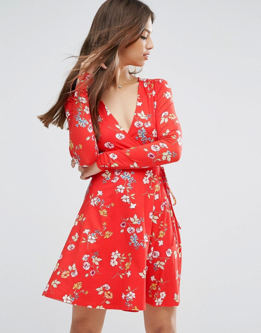 Wrap Tea Dress With Long Sleeves In Red Floral Print Multi - style: faux wrap/wrap; neckline: v-neck; waist detail: belted waist/tie at waist/drawstring; secondary colour: white; predominant colour: true red; occasions: casual, creative work; length: just above the knee; fit: body skimming; fibres: viscose/rayon - stretch; sleeve length: long sleeve; sleeve style: standard; pattern type: fabric; pattern: florals; texture group: jersey - stretchy/drapey; multicoloured: multicoloured; season: a/w 2016; wardrobe: highlight