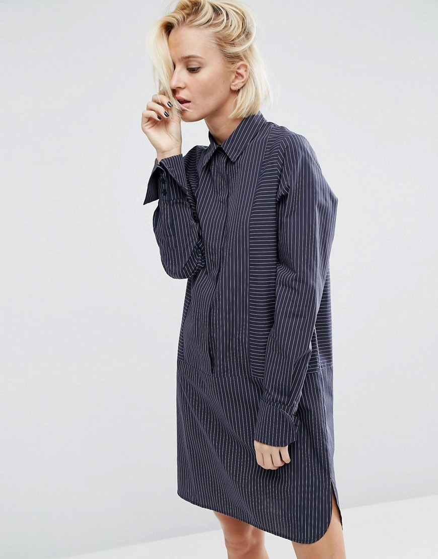 Cotton Shirt Dress With Oversized Cuff In Pinstripe Navy - style: shirt; neckline: slash/boat neckline; fit: loose; pattern: plain; predominant colour: navy; occasions: casual, creative work; length: just above the knee; fibres: cotton - 100%; sleeve length: long sleeve; sleeve style: standard; texture group: crepes; pattern type: fabric; season: a/w 2016