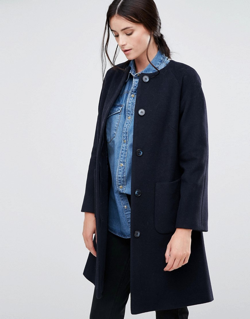 Collarless Swing Coat In Navy Navy - pattern: plain; collar: round collar/collarless; style: single breasted; length: mid thigh; predominant colour: navy; occasions: casual; fit: straight cut (boxy); fibres: wool - mix; sleeve length: long sleeve; sleeve style: standard; collar break: high; pattern type: fabric; texture group: woven bulky/heavy; wardrobe: basic; season: a/w 2016