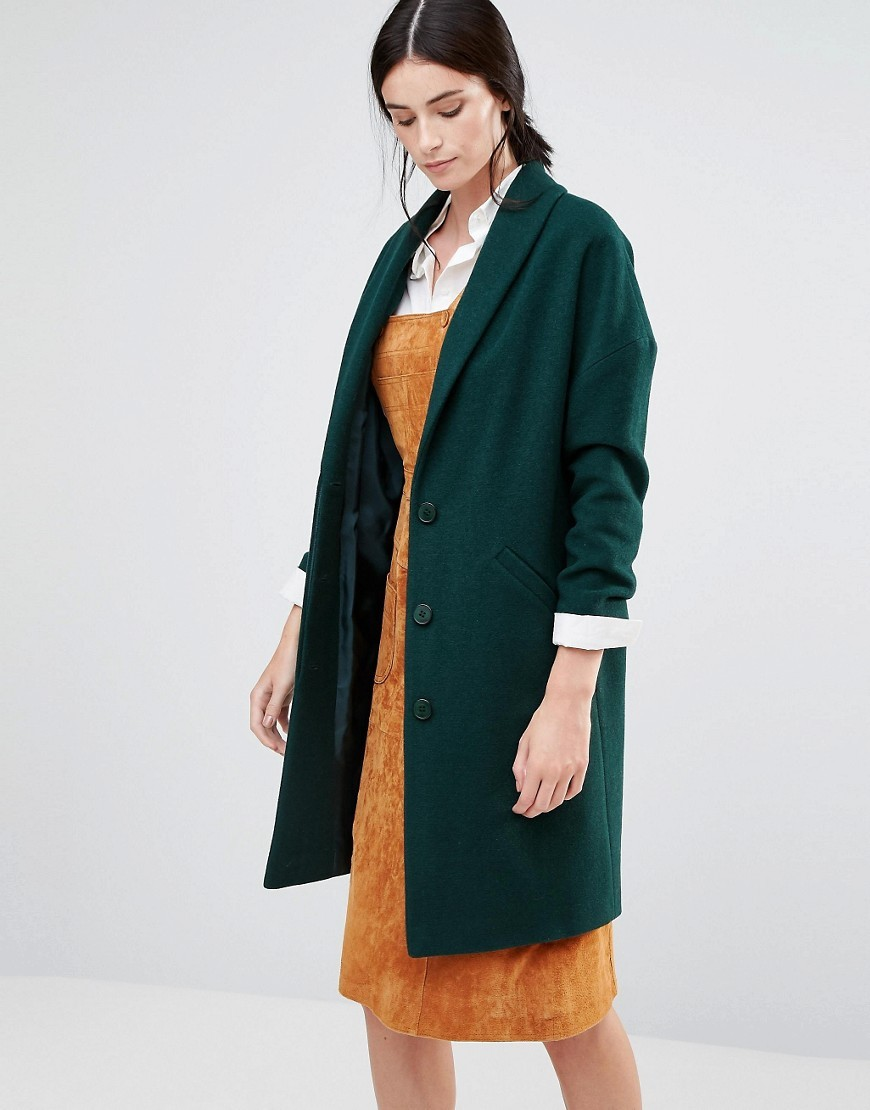Ovoid Ema Coat In Green Forest Green - pattern: plain; style: single breasted; length: on the knee; fit: slim fit; collar: standard lapel/rever collar; predominant colour: dark green; occasions: casual; fibres: wool - mix; sleeve length: long sleeve; sleeve style: standard; collar break: medium; pattern type: fabric; texture group: woven bulky/heavy; season: a/w 2016