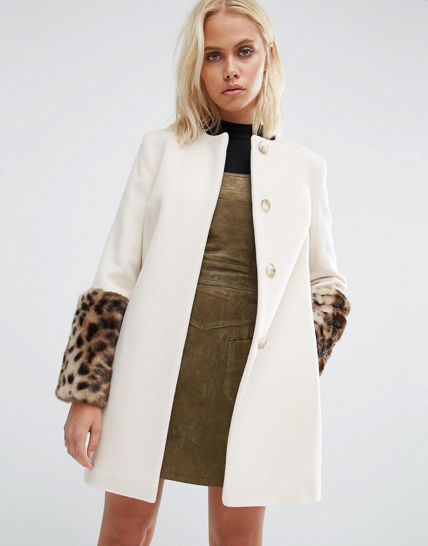 Faux Fur Cuff Coat In Cream With Jaguar Print Fur Cream/ Jaguar - pattern: plain; collar: round collar/collarless; style: single breasted; length: on the knee; predominant colour: ivory/cream; secondary colour: camel; occasions: casual; fit: straight cut (boxy); fibres: wool - mix; sleeve length: long sleeve; sleeve style: standard; collar break: high; pattern type: fabric; texture group: woven bulky/heavy; embellishment: fur; multicoloured: multicoloured; season: a/w 2016; wardrobe: highlight