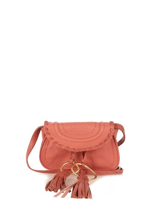 Polly Mini Leather Cross Body Bag - predominant colour: coral; occasions: casual, creative work; type of pattern: standard; style: saddle; length: across body/long; size: small; material: leather; embellishment: tassels; pattern: plain; finish: plain; season: a/w 2016; wardrobe: highlight