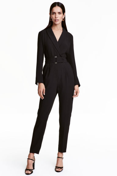 V Neck Jumpsuit - length: standard; neckline: v-neck; pattern: plain; predominant colour: black; occasions: evening; fit: body skimming; fibres: polyester/polyamide - stretch; sleeve length: long sleeve; sleeve style: standard; style: jumpsuit; pattern type: fabric; texture group: jersey - stretchy/drapey; season: a/w 2016; wardrobe: event
