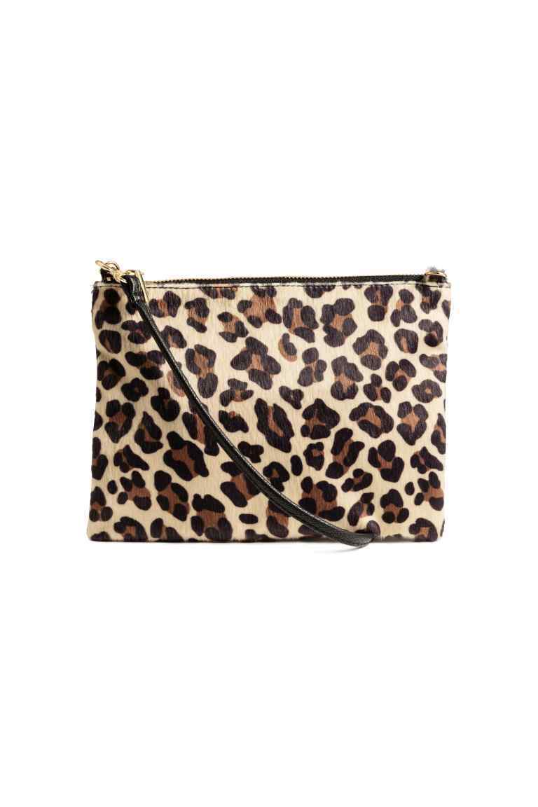 Small Shoulder Bag - predominant colour: stone; secondary colour: black; occasions: casual; type of pattern: light; style: shoulder; length: shoulder (tucks under arm); size: small; material: faux leather; pattern: animal print; finish: plain; season: a/w 2016; wardrobe: highlight; trends: opulent prints