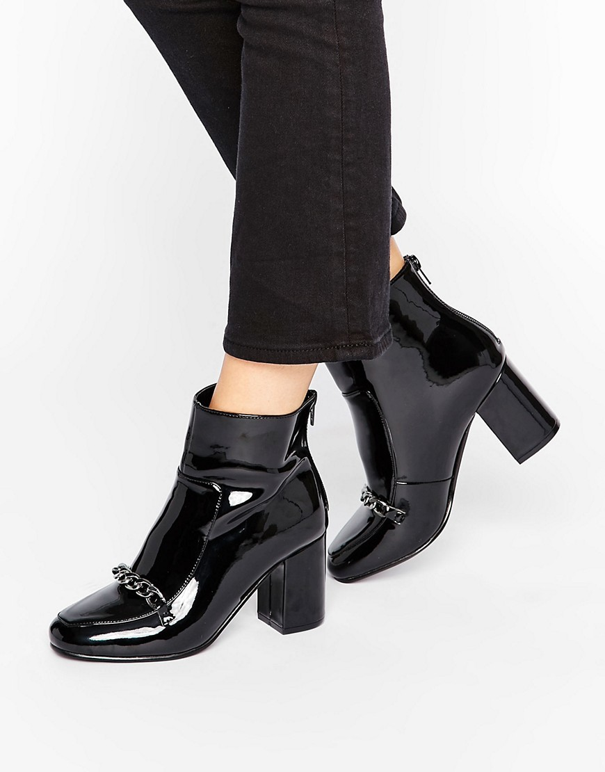 Ramma Chain Ankle Boots Black Patent - predominant colour: black; occasions: casual; material: faux leather; heel height: high; heel: block; toe: round toe; boot length: ankle boot; style: standard; finish: patent; pattern: patterned/print; embellishment: chain/metal; season: a/w 2016; wardrobe: highlight