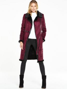 Long Faux Shearling Biker Coat - pattern: plain; collar: wide lapels; style: single breasted; length: on the knee; predominant colour: magenta; occasions: casual, creative work; fit: tailored/fitted; fibres: sheepskin - 100%; sleeve length: long sleeve; sleeve style: standard; collar break: medium; pattern type: fabric; texture group: sheepskin; season: a/w 2016; wardrobe: highlight