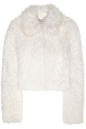 Maida Cropped Shearling Coat Off White - pattern: plain; length: standard; fit: loose; predominant colour: white; occasions: casual; fibres: sheepskin - 100%; style: fur coat; collar: shirt collar/peter pan/zip with opening; shoulder detail: added shoulder detail; sleeve length: long sleeve; sleeve style: standard; texture group: fur; collar break: high; pattern type: fabric; season: a/w 2016; wardrobe: highlight