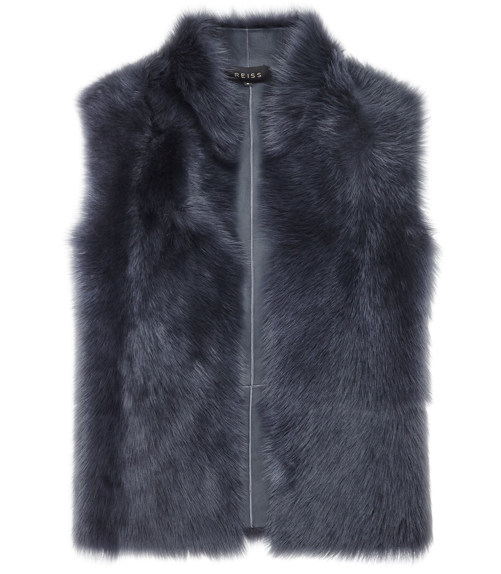 Tessa Womens Reversible Shearling Gilet In Blue - pattern: plain; sleeve style: sleeveless; style: gilet; collar: funnel; predominant colour: navy; occasions: casual, creative work; length: standard; fit: straight cut (boxy); fibres: sheepskin - 100%; sleeve length: sleeveless; texture group: fur; collar break: high; pattern type: fabric; pattern size: standard; season: a/w 2016; wardrobe: highlight