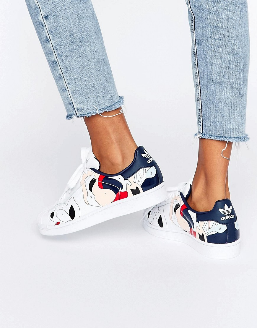 Originals X Rita Ora Paint Print Superstar Trainers White - predominant colour: white; secondary colour: navy; occasions: casual; material: leather; heel height: flat; toe: round toe; style: trainers; finish: plain; pattern: patterned/print; shoe detail: moulded soul; season: a/w 2016; wardrobe: highlight