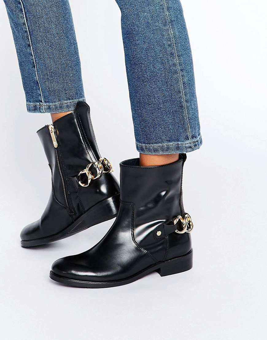 Polly Chain Ankle Boots Black - secondary colour: gold; predominant colour: black; occasions: casual, creative work; material: leather; heel height: flat; heel: standard; toe: round toe; boot length: ankle boot; style: standard; finish: patent; pattern: plain; embellishment: chain/metal; season: a/w 2016; wardrobe: highlight