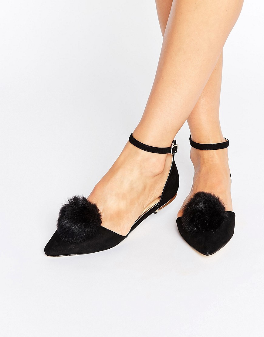 Goldie Pom Pom Ankle Strap Point Flat Shoes Black Suedette - predominant colour: black; occasions: casual, creative work; heel height: flat; ankle detail: ankle strap; toe: pointed toe; style: ballerinas / pumps; finish: plain; pattern: plain; embellishment: pompom; material: faux suede; wardrobe: basic; season: a/w 2016