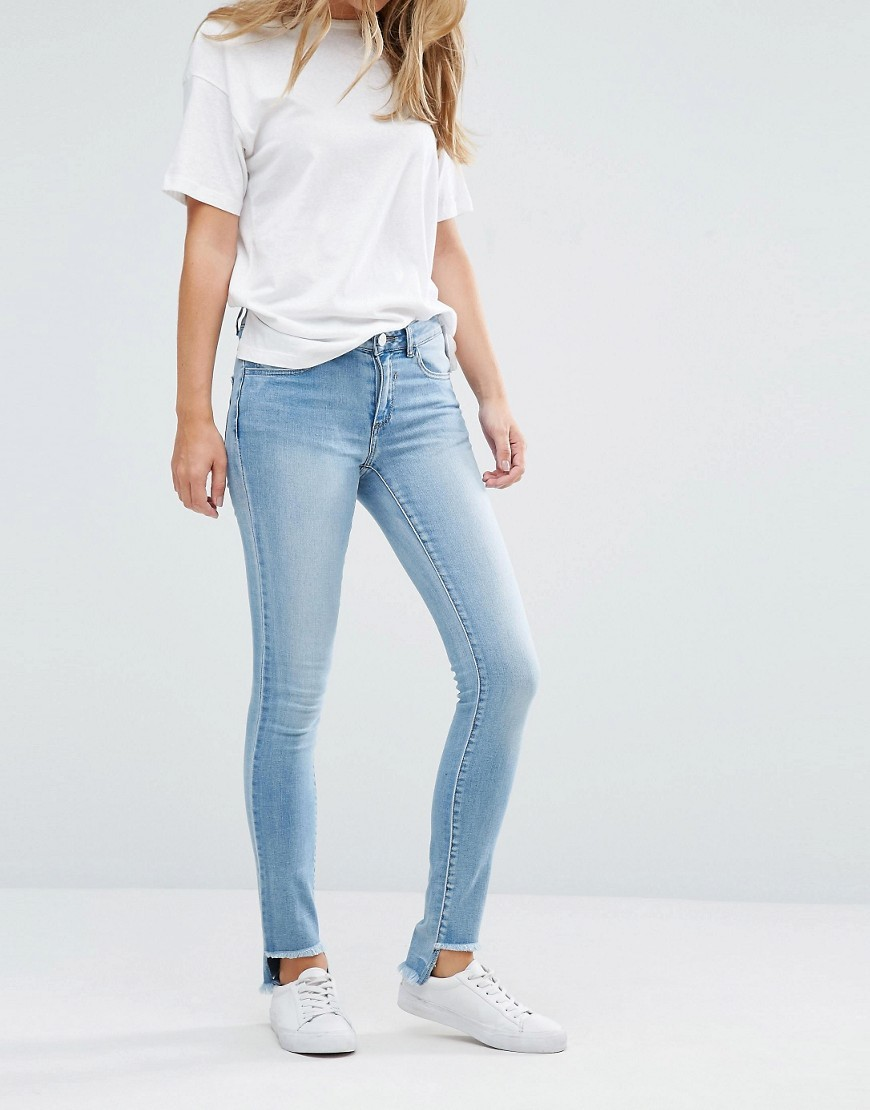 Raw Stepped Hem Skinny Jeans Blue - style: skinny leg; length: standard; pattern: plain; pocket detail: traditional 5 pocket; waist: mid/regular rise; predominant colour: pale blue; occasions: casual; fibres: cotton - stretch; jeans detail: washed/faded; texture group: denim; pattern type: fabric; season: a/w 2016