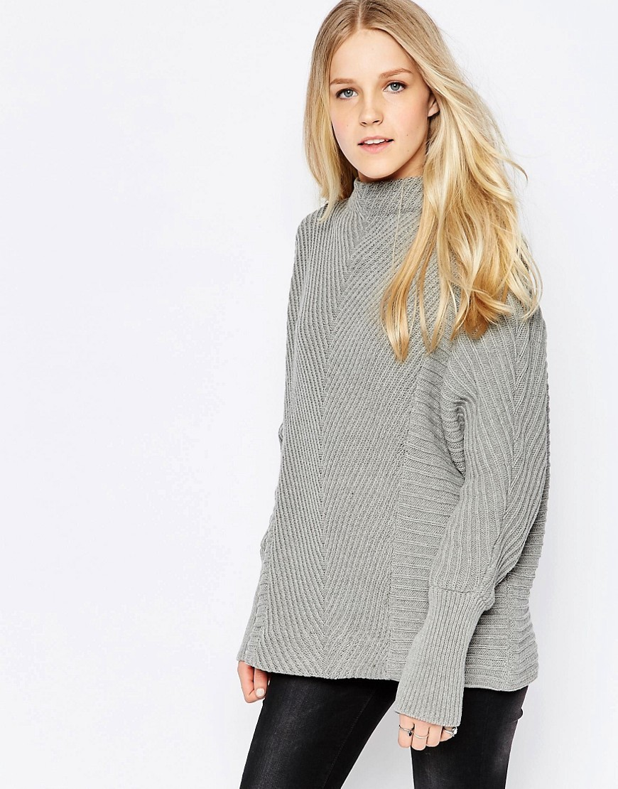 Indie High Neck Textured Jumper In Grey Indie High Neck - pattern: plain; neckline: high neck; style: standard; predominant colour: light grey; occasions: casual; length: standard; fibres: cotton - mix; fit: loose; sleeve length: long sleeve; sleeve style: standard; texture group: knits/crochet; pattern type: knitted - fine stitch; wardrobe: basic; season: a/w 2016